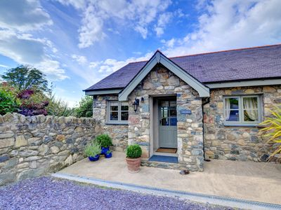 Photo for Adjoining another cottage near Caernarfon is Ysgubor with lovely views across the Menai Strait to An