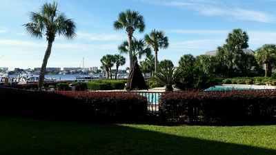 Photo for Garden-level coastal condo w/ patio, shared pool & sound views!