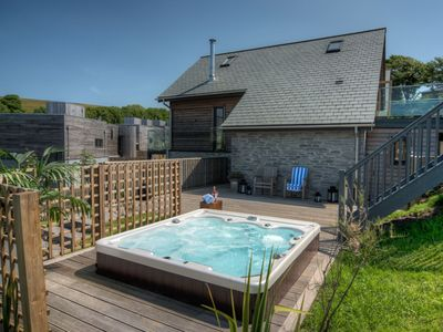 Photo for Beautiful holiday home with hot tub, just a walk away from Talland beach...