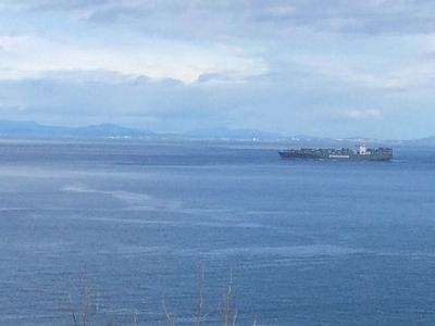 Deck shot - one of several ships crossing daily. Victoria BC in the background.