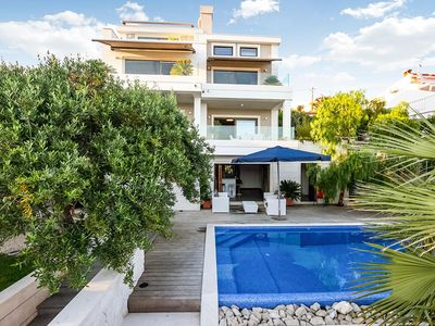 Photo for This contemporary and luxurious villa sleeps up to twelve guests, and has five bedrooms. It is situa