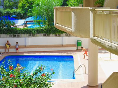 Photo for Central apartment for 4 people with pool, air conditioning and terrace