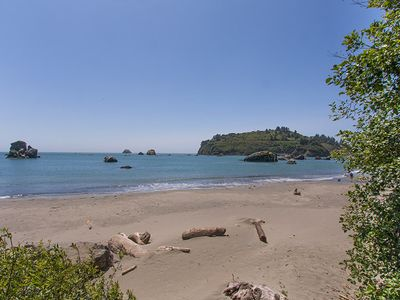 Photo for Scenic Cove~ Stroll down a wooded trail to the beach from this spacious home.