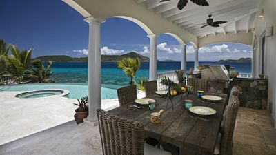 Outdoor dining by pool with a totally private view and access to ocean.