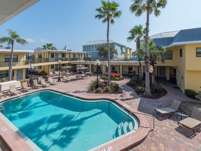 Photo for Perfect Couples Getaway! Beach Access directly Across the Street! Mins from Shopping & Dining