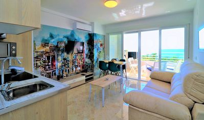 Photo for Beachfront apartment with pool