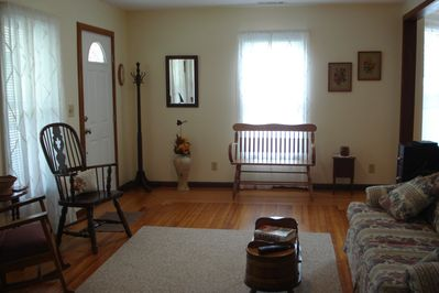 Large living room w/ sofa (double bed), lots of good seating, DISH TV, DVD