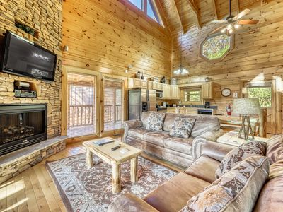 Photo for Charming log cabin nestled in the mountains w/ a private hot tub