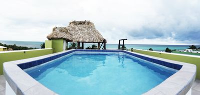 Photo for March and April Specials....Great Location. Amazing roof top view with pool!!~