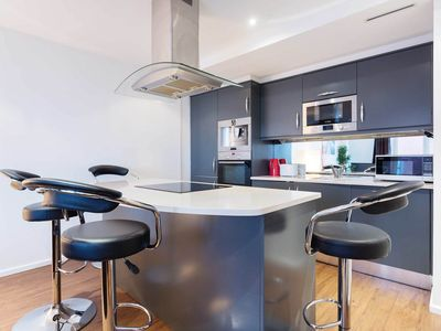 Photo for Sleek, sophisticated apartment in docklands in the heart of London (Veeve)