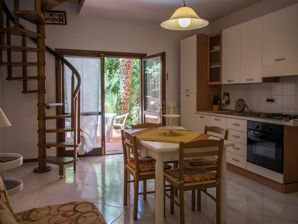 Apartment with air conditioning, BBQ and Garden 700 meters from the ...