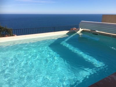 the heated pool has beautiful uninterrupted views of the sea