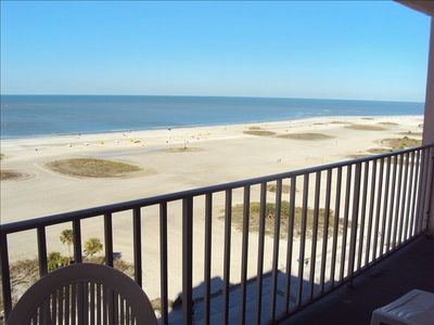 Large balcony w/lounge chairs & dinette table, panaramic views of sunset & beach