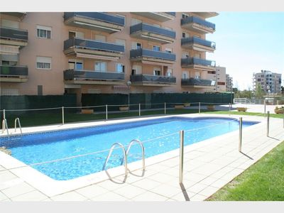 Photo for Nice ground floor 450m from the beach of La Pineda, with pool and garage