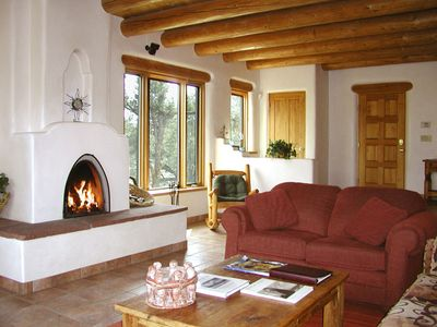 """Wood burning traditional southwest """"Kiva: fireplace and more over sized windows to capture the views"""