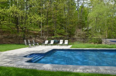 Pool with deck chairs