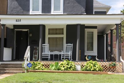Large rocking chairs on the front porch facing Ann Avenue. Come sit a spell.