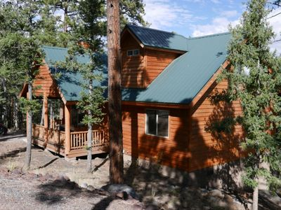 Photo for Beautiful mountain cabin backing to National Forest