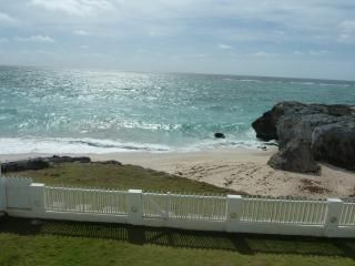View of villa front lawn overlooking secluded beach
