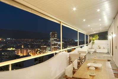 night view of east center Athens with mountains from the 20 meters  long veranda