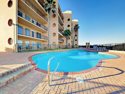 Pool - The condo complex has a large pool and relaxing hot tub overlooking the water.