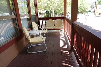 """Our Chalet guests L-O-V-E their pleasant """"porch time"""" on our glider and chairs!"""