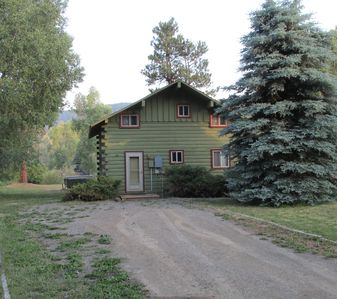 Photo for River Lodge Log Cabin on the San Juan River Bordering National Forest Free WIFI