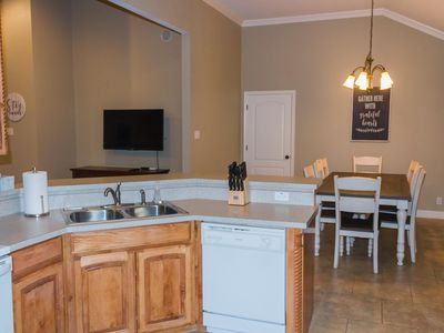 Photo for Charming downtown home steps away from the city square, shopping, local dining