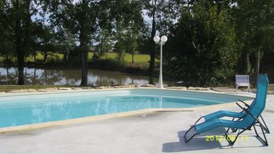 Photo for Spacious villa not overlooked with swimming pool and private pond for fishing