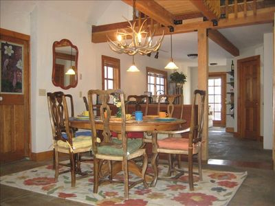 Dining Area with vaulted ceiling.