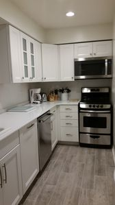 Newly remodeled kitchen with unique design and extra counter space.