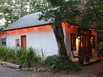 Charming cozy cottage secluded in private woods in great close in location.