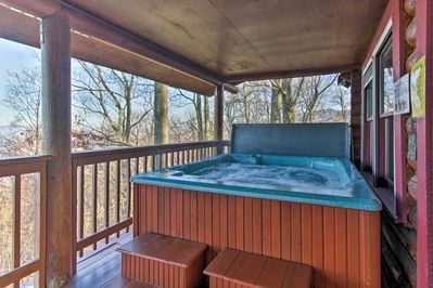 Relax with stunning mountain views in the vacation rental's private hot tub.