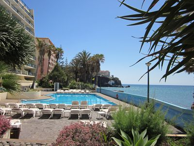 Photo for Funchal beach hotel 2 bedroom apartment with swimming pool, fantastic sea-views