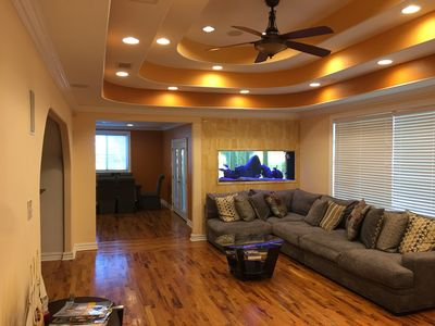"""Den with 75""""4K tv and 5.1 surround sound"""