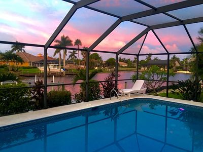 Photo for 4 bedrooms (2 MASTER) 3 baths, south facing, saltwater pool boat dock golf access