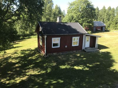 Photo for Charming cottage on the lake on the farm Söderlund near the Norwegian border