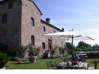 Photo for Elegant historic villa so tastefully  reconstructed according to Tuscan style with stunning views, private garden and swimming pool.