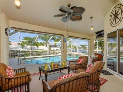Photo for SW Cape Coral | Gulf Access | A boater`s dream: boat dock with lift, relax at the Tiki Hut bar