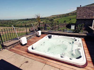 Decked area with hot tub