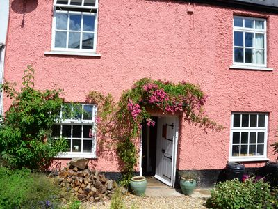Photo for 17th Century character cottage in pretty Devon village