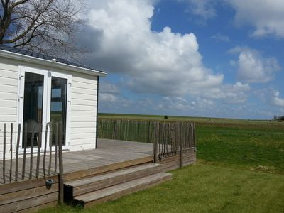 Photo for Luxury comfortable chalet in a holiday park, directly situated by the Waddenzee