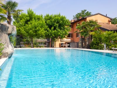 Photo for Riverside villa with pool