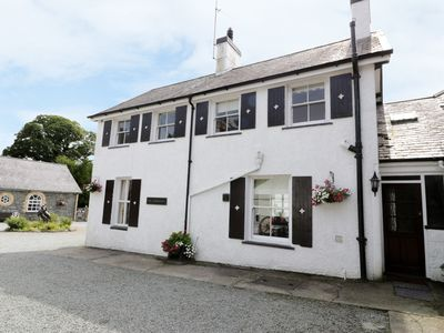 Photo for GARDENERS COTTAGE, pet friendly, with open fire in Criccieth, Ref 383