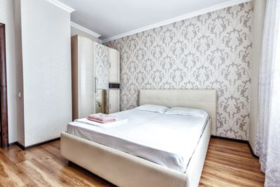 Bedroom with the comfortable bed for two persons