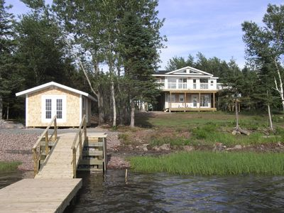 Photo for Luxurious retreat, nestled on the shores of the Bay with dock, kayaks and sauna