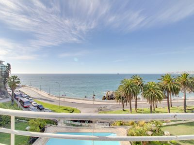 Large oceanfront apt. with a balcony & shared pool across from the beach!