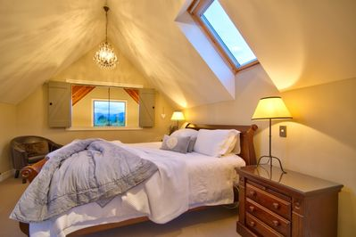 Master bedroom-superking bed with mountain views