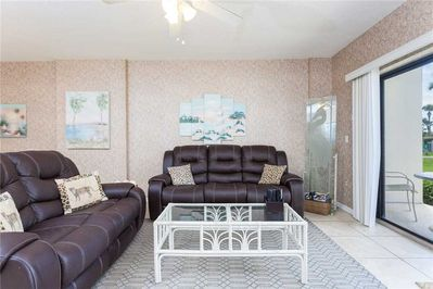 Spacious Living Room - Large comfortable couches and ceiling fan so you can enjoy your evenings with family and lots of breathing space.