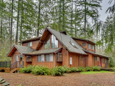 Photo for Spacious cabin w/ private hot tub, fireplace & free WiFi - near skiing - Dogs OK